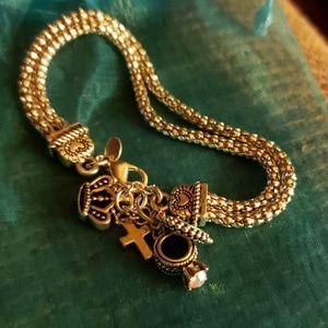 Cute silver tone charms bracelet